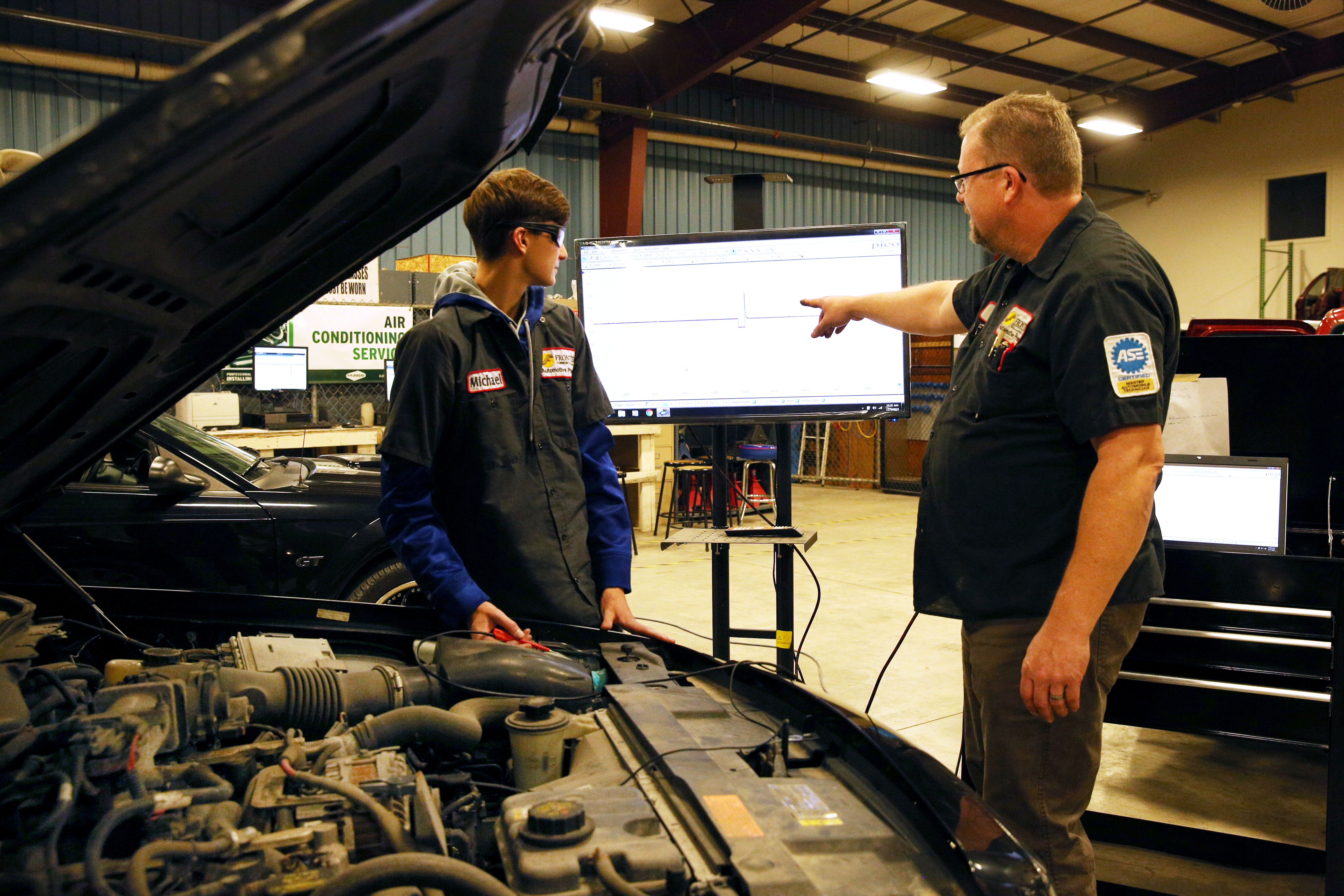 Student and instructor in the automotive lab