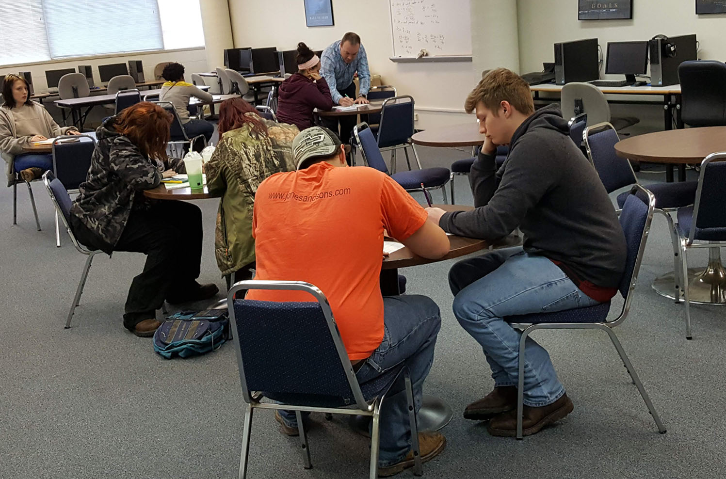 Students studying at a table in the Academic Success Center