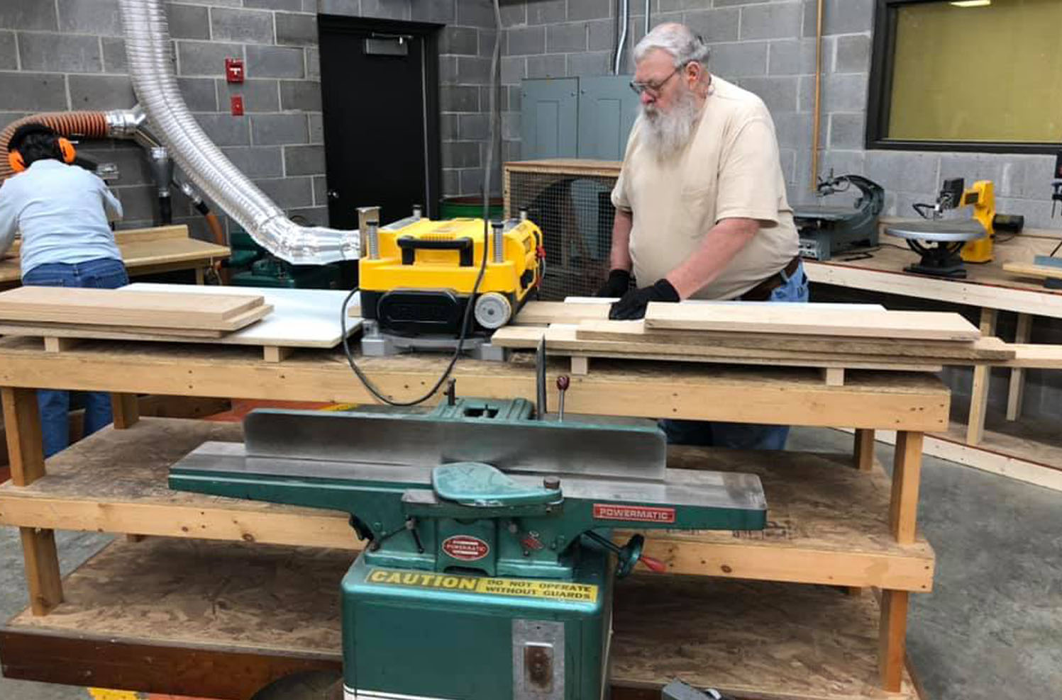 Man in the Woodworking Shop cutting boards