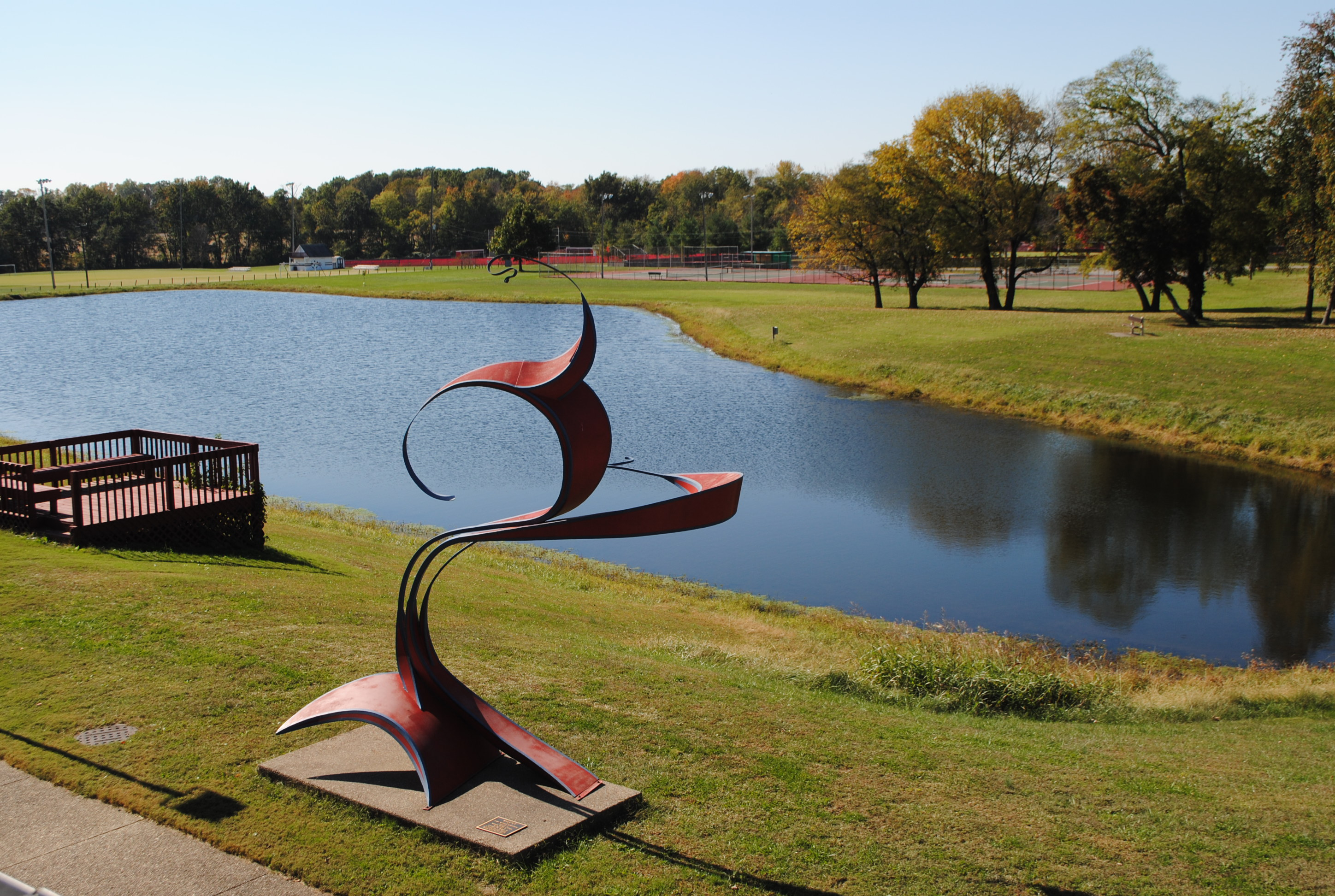 Photo of WVC Campus Grounds featuring Balance artwork and campus lake