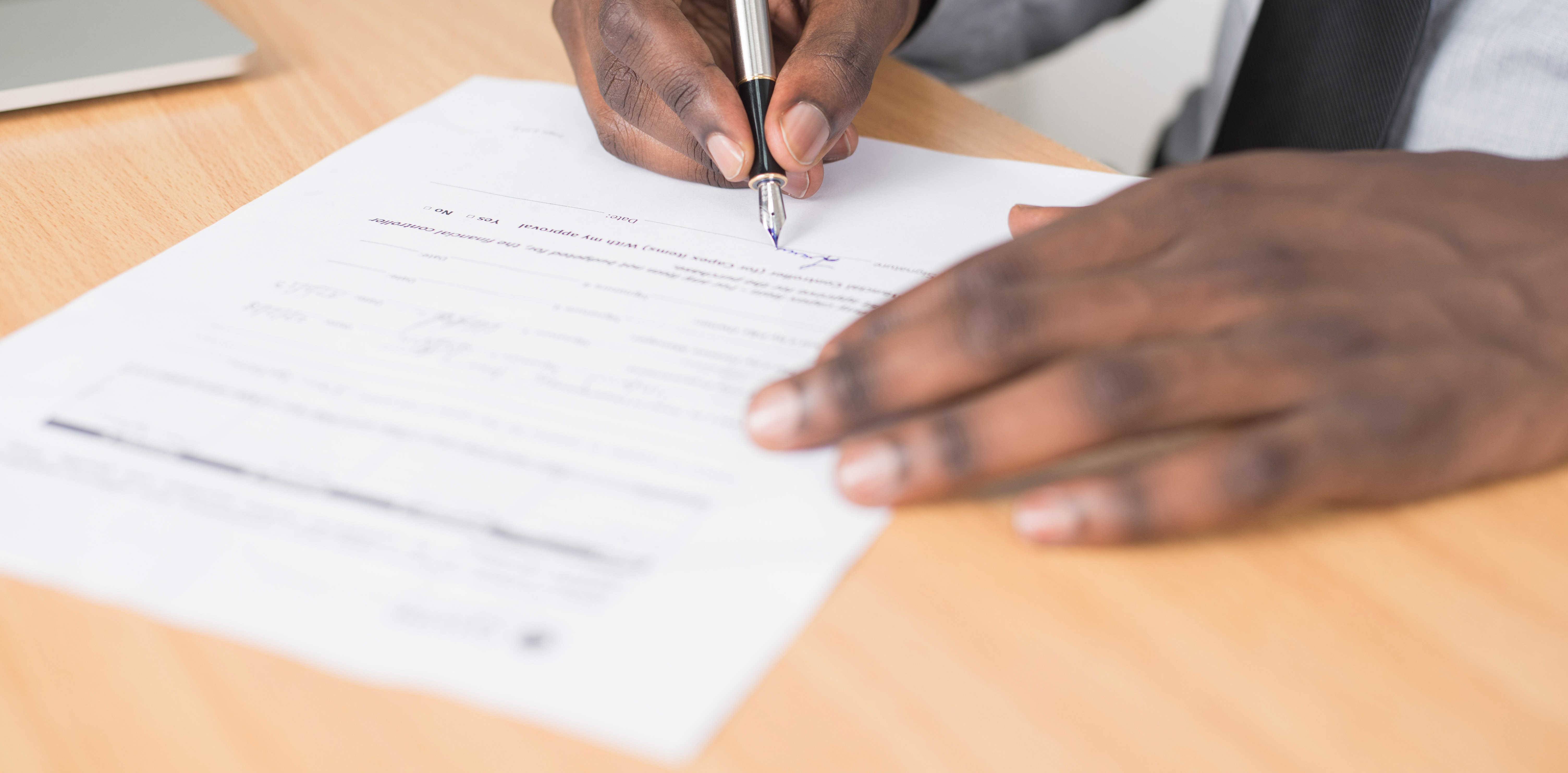 Person Signing Paper