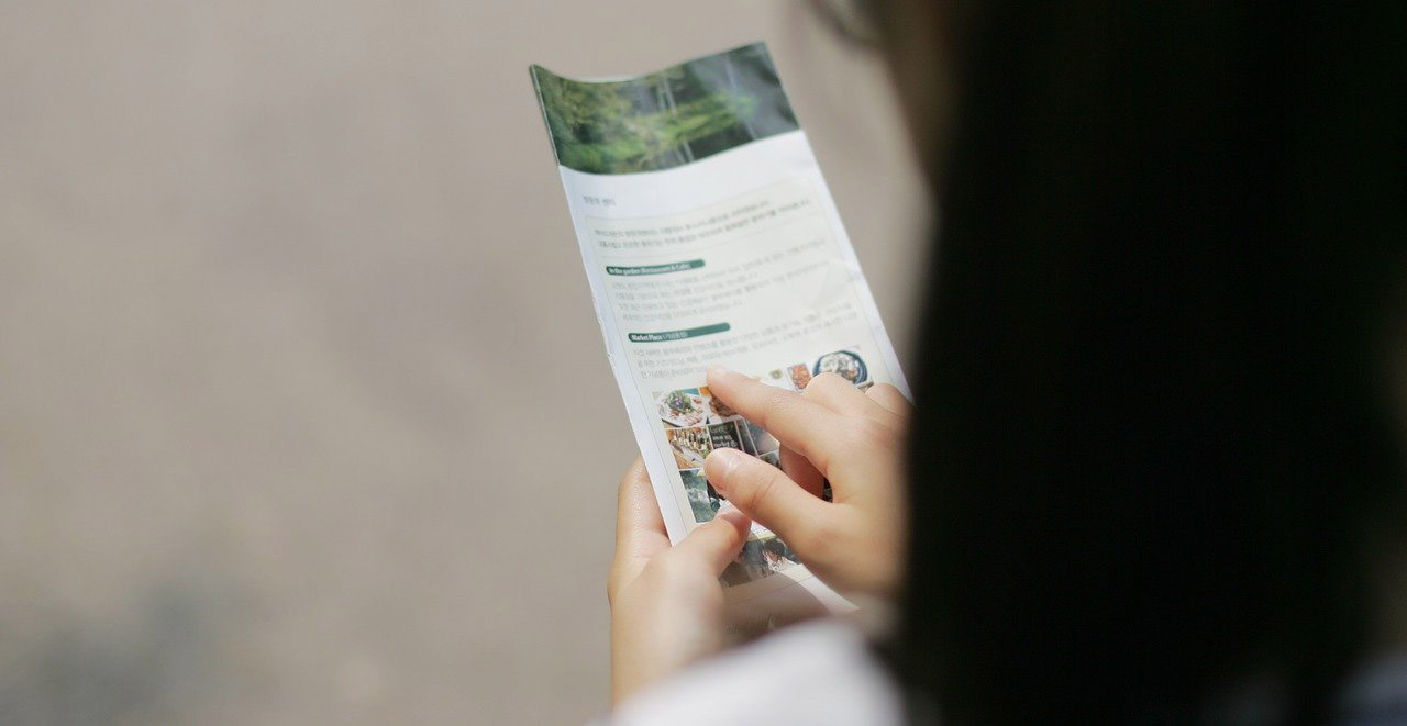 Woman Reading a Brochure