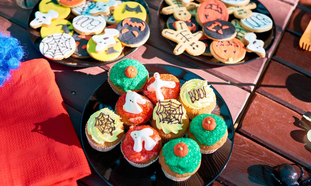 Collection of decorated cookies and cupcakes